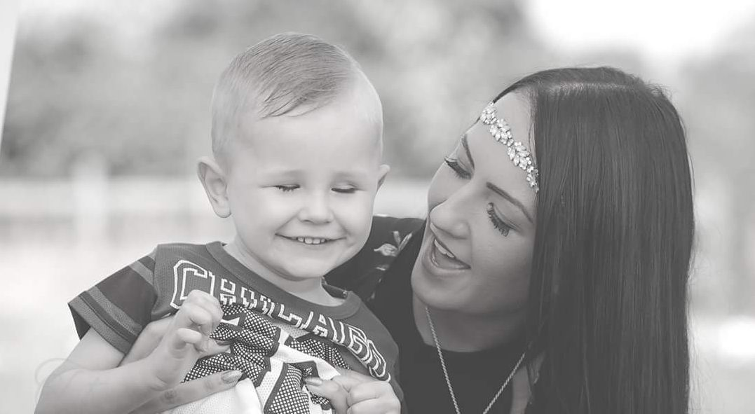 toddler and mum smiling